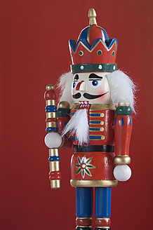 Close up of Nutcracker figurine against red background - ASF004675