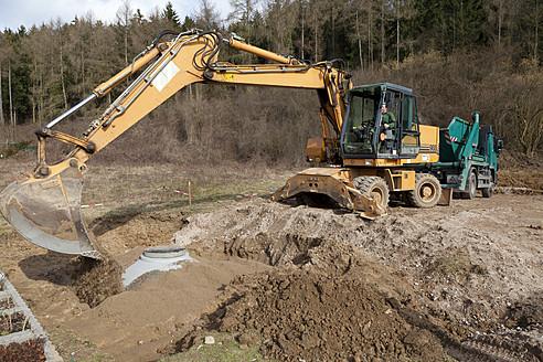 Europe, Germany, Rhineland Palatinate, Installing cistern of rainwater - CSF015965