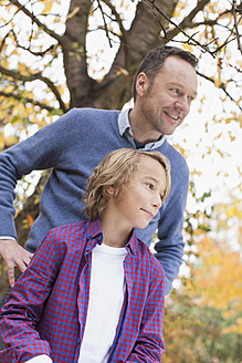 Germany, Leipzig, Father and son looking away, smiling - BMF000621