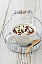 Mousse au Chocolat with grated white chocolate in cup on table - ECF000165