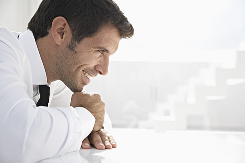 Spain, Businessman thinking, smiling - PDYF000331