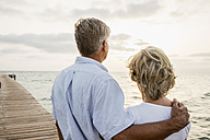 Spain, Senior couple standing at the sea - JKF000016