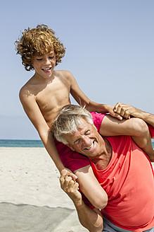 Spain, Grandfather carrying grandson on shoulder - JKF000102