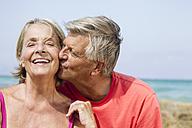 Spain, Senior man kissing to woman, close up - JKF000120