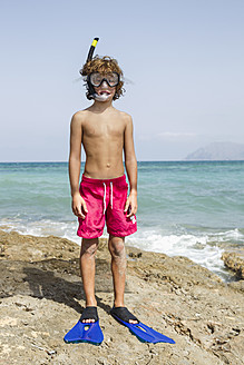 Spain, Boy with diving equipment on beach - JKF000144