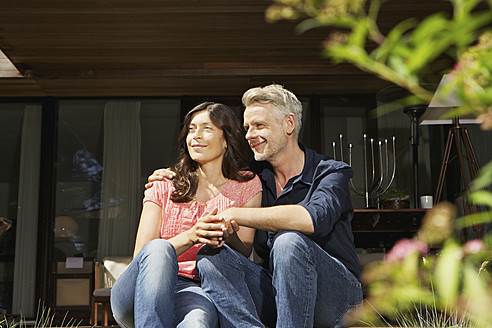 Germany, Berlin, Mature couple relaxing on terrace - SKF001105