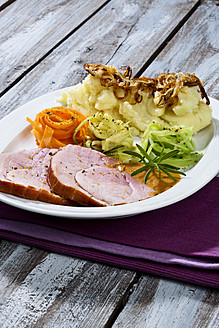 Smoked pork chop, mashed potatoes with roasted onions on plate, close up - MAEF005416