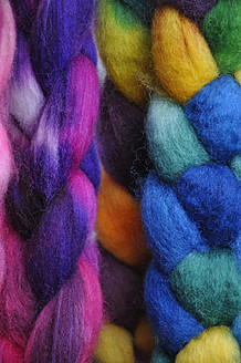 Multi coloured wool pigtails, close up - AXF000373