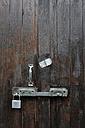 Germany, Bavaria, Wooden door with door lock - AXF000414
