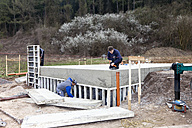 Europe, Germany, Rhineland Palatinate, Men constructing house building - CSF016025