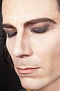 Man with make up, eyes closed, close up - ND000272
