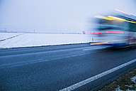 Austria, Cargo truck moving on country road in winter - EJWF000163