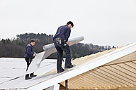 Europe, Germany, Rhineland Palatinate, Workers roofing on house - CSF016095