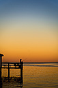 USA, Texas, Rockport, Mature woman holding fishing rod on pier - ABA000688