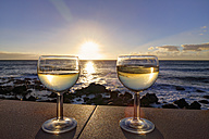 Spain, La Gomera, Glasses with white wine on wall at Valle Gran Rey - SIEF003077