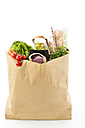 Groceries in paper bag on white background, close up - MAEF005522