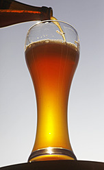 Germany, Bavaria, Wheat beer pouring in beer glass - JTF000268
