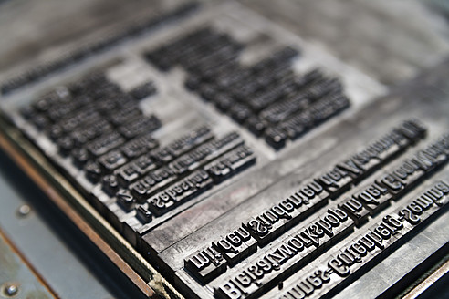 Germany, Bavaria, Detail of lead typesetting at traditional print shop - TC003293