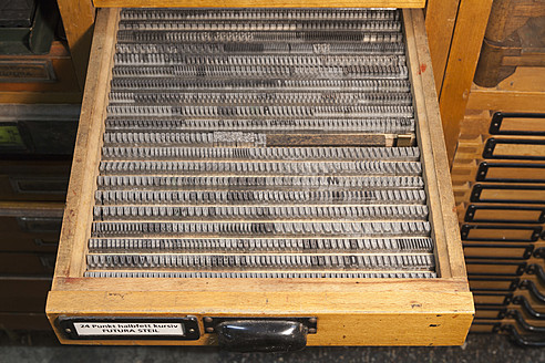 Germany, Bavaria, Detail of lead typesetting at traditional print shop - TC003296