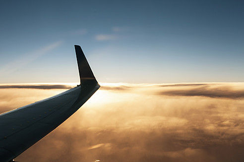 Aeroplane wing above cloud at sunset - DBF000232