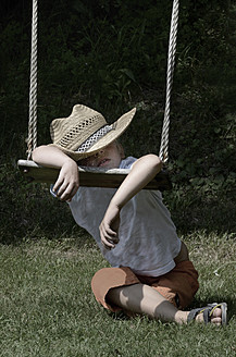 Austria, Boy sleeping on swing - CWF000003