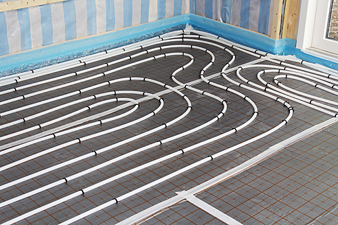 Europe, Germany, Rhineland-Palatinate, Underfloor heating helixes while house building - CSF016229