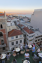 Turkey, Istanbul, View of  waterpipe cafe with city in background - SIE003265