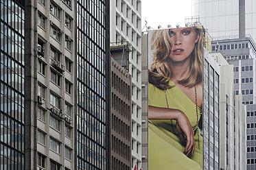 China, Hong Kong, Escada fashion advertising between high-rise buildings in Chung Wan at Central District - MIZ000182
