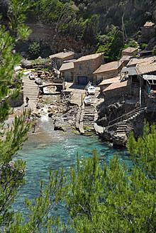 Spain, View of houses in Cala de Deia - MIZ000222