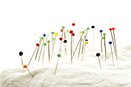 Pin cushion against white background, close up - MAEF005667