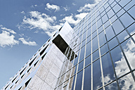Germany, Duesseldorf, Modern business building against cloudy sky - MF000474