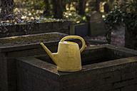 Germany, North Rhine Westphalia, Cologne, Watering can at cemetery Melatenfriedhof - KJ000192