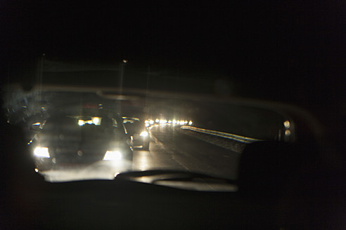 Germany, Reflection of car from rear view mirror - TCF003302