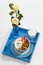 Bowl of cornflower with strawberries and glass of milk on white background - CSF016599