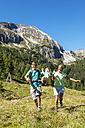 Austria, Salzburg, Parents walking and swinging son on mountains at Altenmarkt Zauchensee - HHF004367