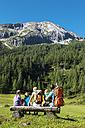 Austria, Salzburg, Family watching mountains at Altenmarkt Zauchensee - HHF004377