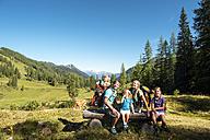 Austria, Salzburg, Family watching mountains at Altenmarkt Zauchensee - HHF004383