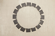 Files forming circle on beige background - BAEF000462
