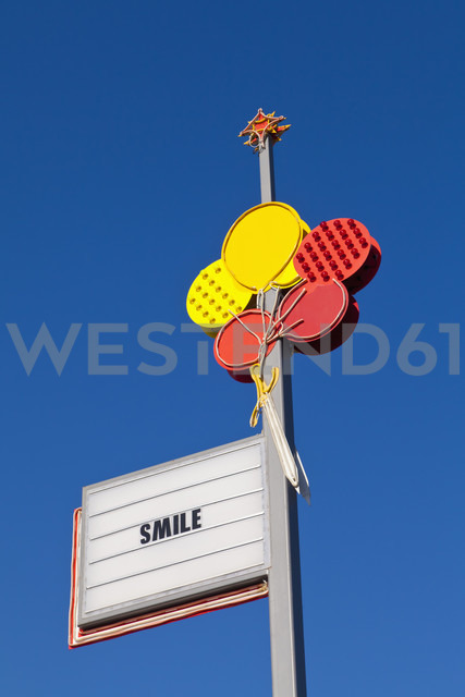 England, Hampshire, Portsmouth, Commercial sign against blue sky - WDF001473