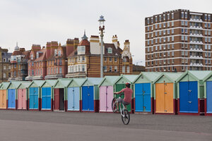 England, Sussex, Brighton, Coloured bathing huts at seafront - WD001507