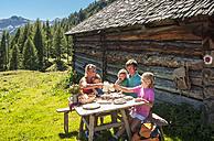 Austria, Salzburg Country, Family having rest at Altenmarkt Zauchensee - HHF004388
