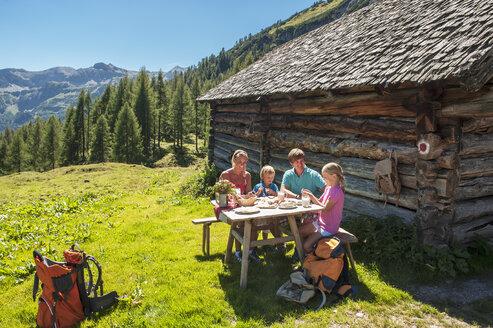 Austria, Salzburg Country, Family having rest at Altenmarkt Zauchensee - HHF004390