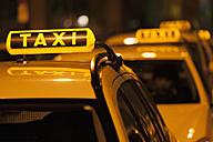 Germany, Bavaria, Munich, Illuminated sign on taxi showing availability - TCF003307