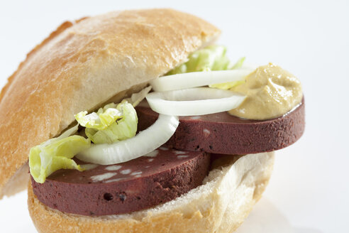 Sandwich of bread roll with black forest ham on white background, close up - CSF017257
