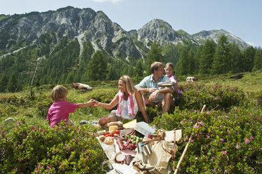 Austria, Salzburg, Family having picnic in mountains - HHF004514