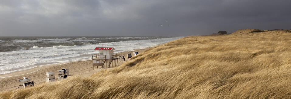 Germany, View of empty beach with roofed wicker beach chairs on Sylt island - ATA000010