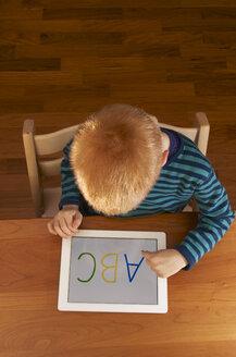 Germany, Baden Wuerttemberg, Constance, Boy using digital tablet - JEDF000016