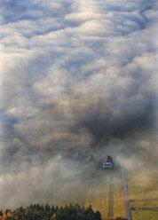 Austria, Salzkammergut, View of farmhouse covered with fog - WW002703
