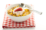 Breakfast bowl of cereals with yogurt and strawberry - MAEF005995