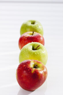 Red and green apples on white background, close up - CSF017504